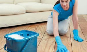 Protect yourself when cleaning your unfinished wood floor by wearing thick gloves.