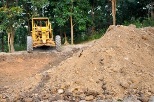 Land grading contractors ensure safety on site.